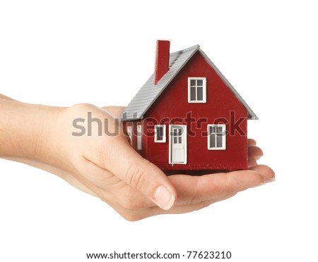 Hand holding house - stock photo