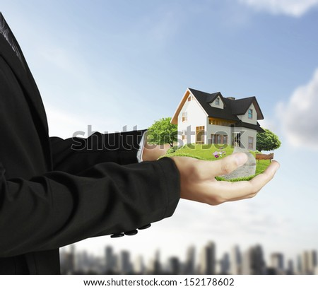 hand holding house architectural model - stock photo