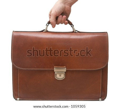 Hand holding isolated brown leather briefcase - stock photo