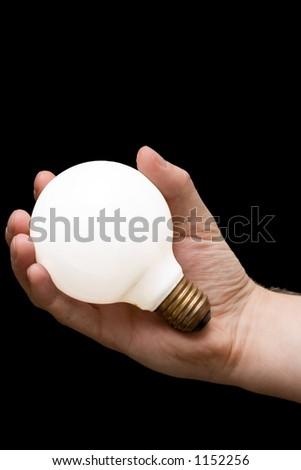 Hand holding isolated light bulb - stock photo