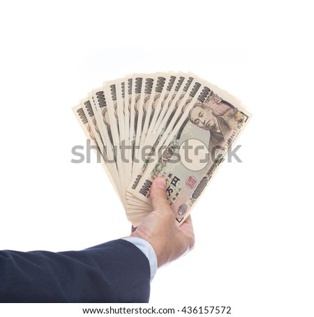 Hand holding Japanese banknote on white background. Japanese money.