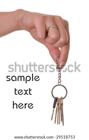 Hand holding keys isolated on the white