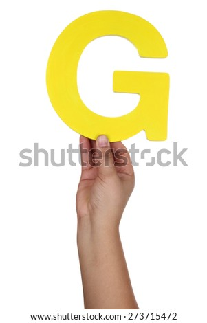 Hand holding letter G from alphabet isolated on a white background - stock photo