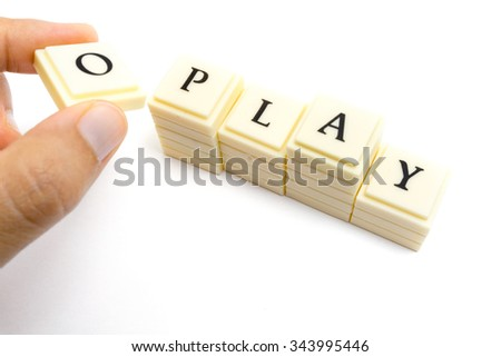 hand holding letter pieces with word play