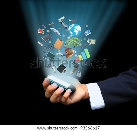 Hand holding magic phone - stock photo