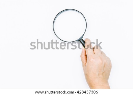 Hand holding magnifying glass  on white background - stock photo