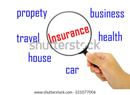 Hand holding magnifying glass with words insurance concept.