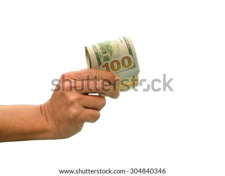 hand holding many bundle of US 100 dollars bank notes isolated on white - stock photo