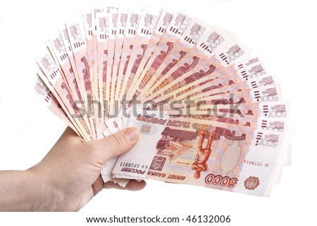 hand holding many of the Russian banknotes
