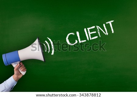 Hand Holding Megaphone with CLIENT Announcement - stock photo