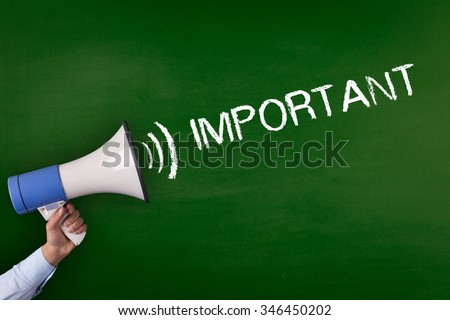 Hand Holding Megaphone with IMPORTANT Announcement - stock photo
