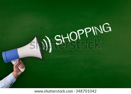 Hand Holding Megaphone with SHOPPING Announcement - stock photo