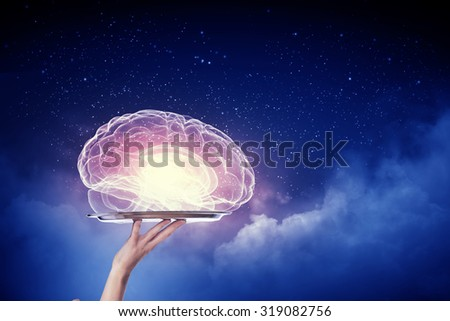Hand holding metal tray with human brain symbol - stock photo