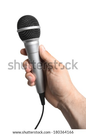 Hand holding microphone on white background