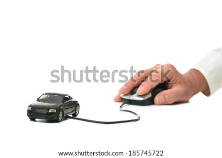 Hand holding miniature car computer mouse isolated on white background - stock photo