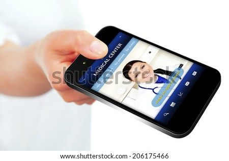 hand holding mobile phone with medical center website. focus on screen - stock photo