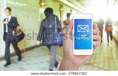 Hand holding mobile phone with 1 new message word on business graphic  background - stock photo