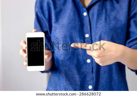 Hand holding mobile smart phone with black screen - stock photo