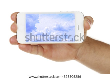 Hand holding mobile smart phone with sky in screen. Cloud computing concept - stock photo
