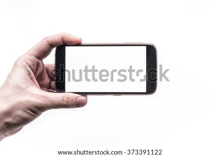 Hand holding mobile smartphone with blank screen on white background - stock photo