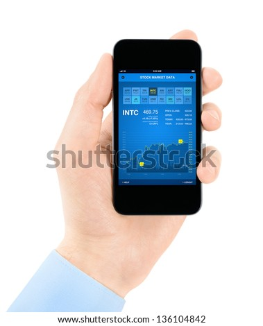 Hand holding mobile smartphone with stock market data application interface. Isolated on white. - stock photo
