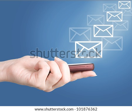 Hand holding modern mobile telephone and letters flaying away, social media concept - stock photo
