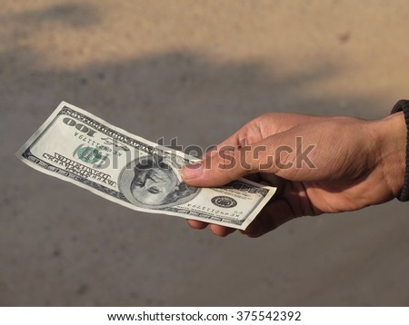 hand holding money dollars