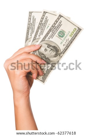 Hand holding money dollars isolated on white background - stock photo