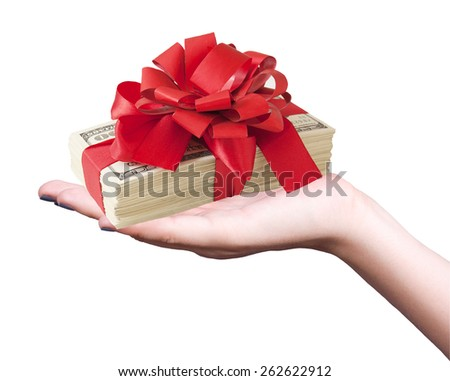 Hand holding money stack with red bow isolated on white background.Money gift concept - stock photo
