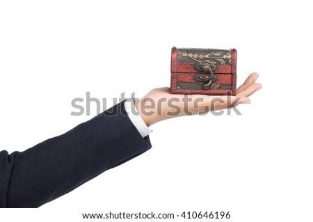 hand holding old ancient chest isolated on white background