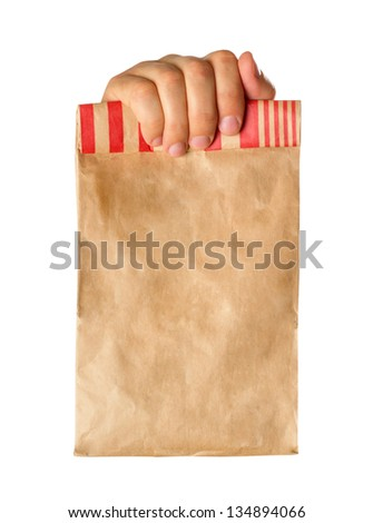 Hand holding or giving a brown paper bag - stock photo