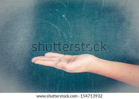 hand holding or showing your product in front of blackboard