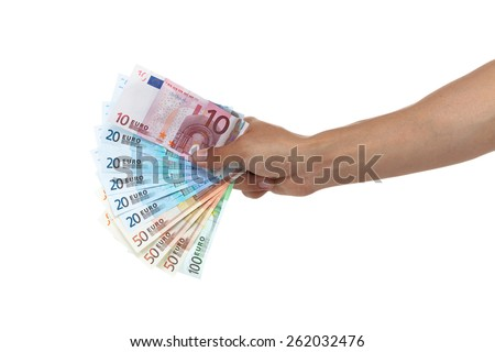 Hand holding out a fan of euro bills from small to large isolated on white  - stock photo