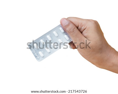 Hand holding  packed of white pills in blister, isolated