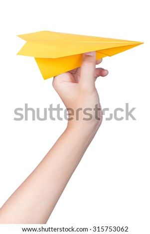 hand holding paper plane  - stock photo