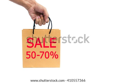 Hand holding paper shopping bag isolated on white background. - stock photo