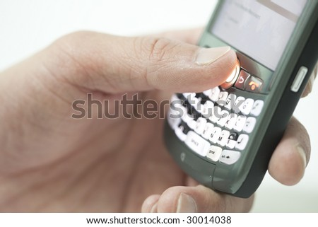 hand holding pda cell phone, concept of receiving email - stock photo
