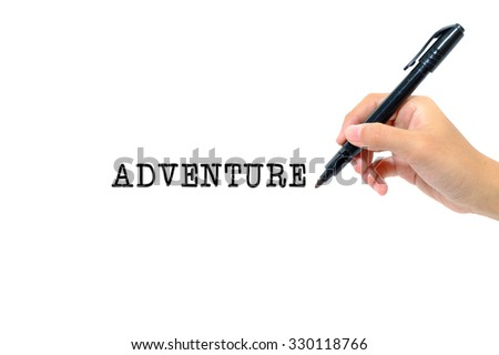 Hand holding pen writing words adventure concept.