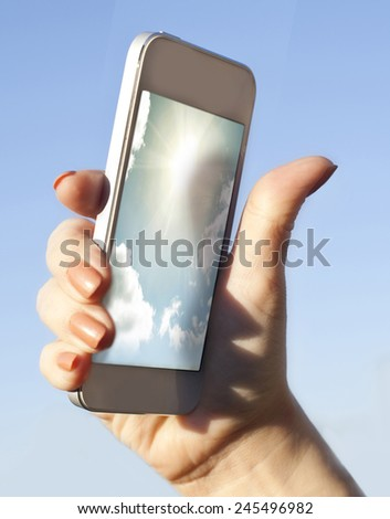 hand holding phone. - stock photo