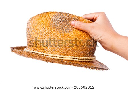 Hand Holding (Pick Choose Select Wear) Handmade Straw Fedora, Fashion Design Style Hat with Rope Strip Isolated on white background. - stock photo