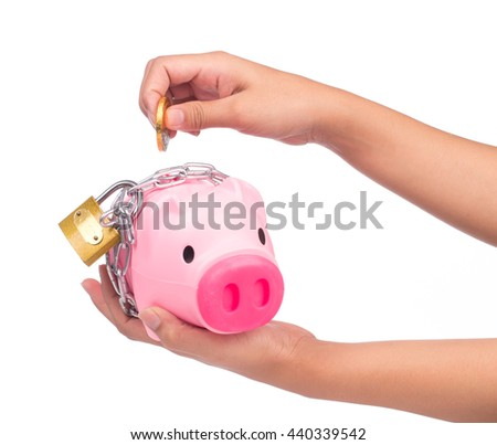 hand holding Piggy bank style money box chained together isolated on white background, concep financial stability