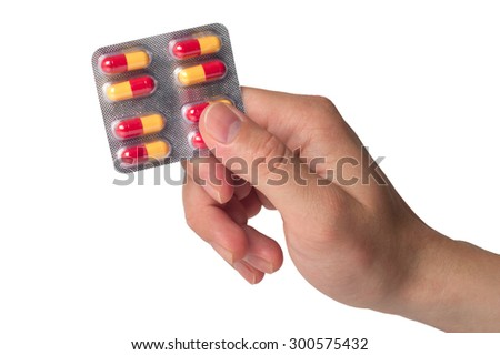 Hand holding pills blister isolated on white background - stock photo