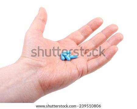 Hand holding  pills. Isolated on white background - stock photo