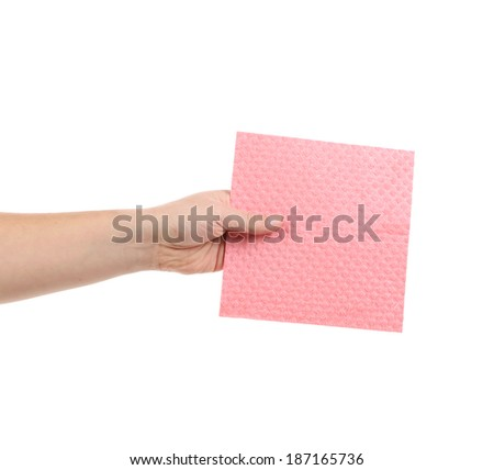Hand holding pink cleaning sponge. Isolated on a white background. - stock photo
