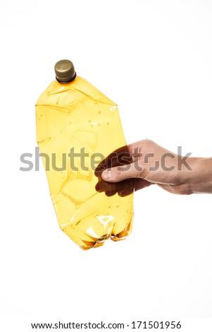 Hand holding plastic bottle over white background - stock photo