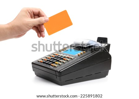 hand holding plastic card and payment machine  isolated on white. - stock photo