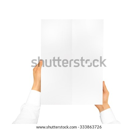 Hand holding poster mock up. Nice mockup to show your design, picture or illustration. Blank sheet hold in hands isolated on white background. Display movie theatre cinema film with poster holder. - stock photo
