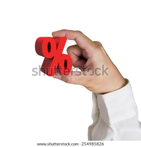 Hand holding  red percentage sign isolated on white background - stock photo