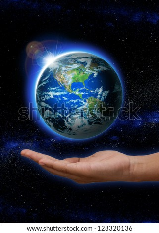Hand  holding Rising Sun over  the world with north and south america.  hand with Planet earth with sunrise in space globe on it. (Elements of this image furnished by NASA) - stock photo