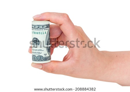 Hand holding rolled 100 dollars banknotes isolated on white background with clipping path